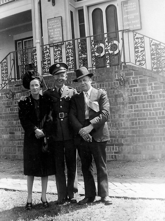 Linnie Mae Coker (mother) Forrest E Coker (son) & Johnnie Austin Coker (father) - There are a few thing to notice in this photo.  Johnnie Coker has a cigar in his hand.  The are standing in from of where the great General Douglas Mac Arthur was born. This was taken on a trip to see their son before leaving for world war 2.  - 1942