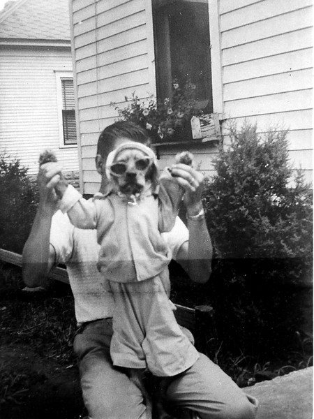 Forrest Coker and my first dog, Taffy.  This might have been taken in back of the home on Pearl street, Havana, 1948? Dad was 29.  You can tell Taffy loved to dress up by her face.