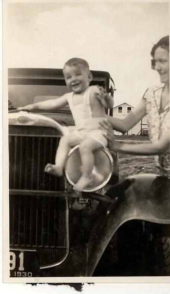 Jewel Hill holding Donald on the car headlight.