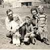 Back of the photo identifies Clyde Saban and wife Vera with Jimmy, Sammy and Billy. Dated May 30, 1942.