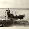 Ted Hill with his boat near McFadden, WY in 1930.
