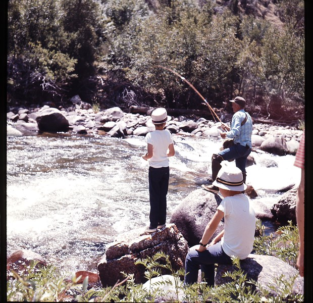 Buster fishing with Bruce and Brian watching.