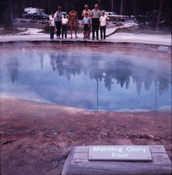 Brian, Elaine, Bruce looking into the Morning Glory Pool at Yellowstone.