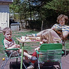 Jonathan (mouth full as usual, but still awake), Grace, and Anala Rodgers in the garden in Hamden CT (mid-1980's)