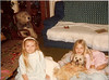 "December 1981<br /> Jeannie, Stacy, & Snoopy<br /> ""Isn't he cute"""