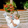 Fred Rodgers reading the Times next to the pool at the Rodgers house on Libertad Privado in Ajijic -- Jonathan Rodgers in the background.