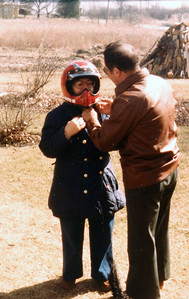 Uncle Bud helping Aunt Gladys with helmet