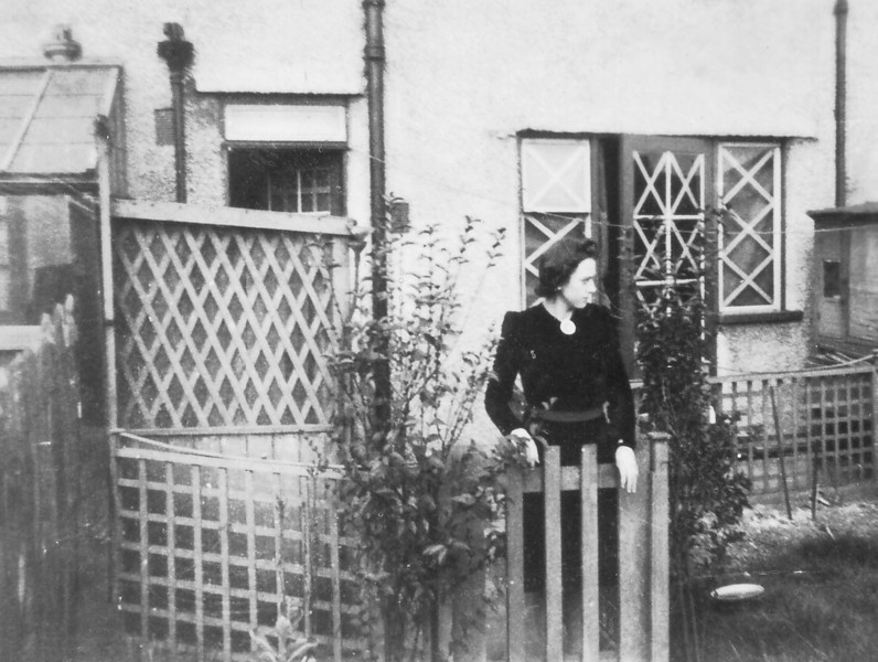 Phil Kavanagh, Ockley Road, West Croydon, (taped windows to prevent flying glass in case of bombs!)