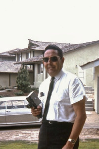 Dad with the movie camera. His gold 1962 Chevy II was in the driveway of the Cathey house--but they didn't live there yet.
