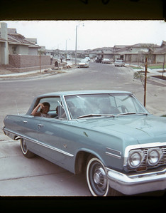 July 1965 231 Street We are the first house occupied in the new section of houses! MP in the back seat of the 1963 Chevy Impala, QIM680