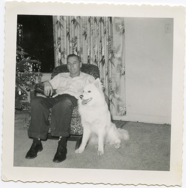 George VanHorn, at House on Naval, with dog, 1960's,