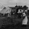 Charlotte Seifert in Connecticut taking clothes from the clothesline.