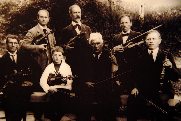 """Old picture from Voss. My grandfather (Klaus Vethe) here to the left and Sigbjørn B. Osa as a little boy. they all played """"hardingafela"""".. an old fiddle from Voss."""