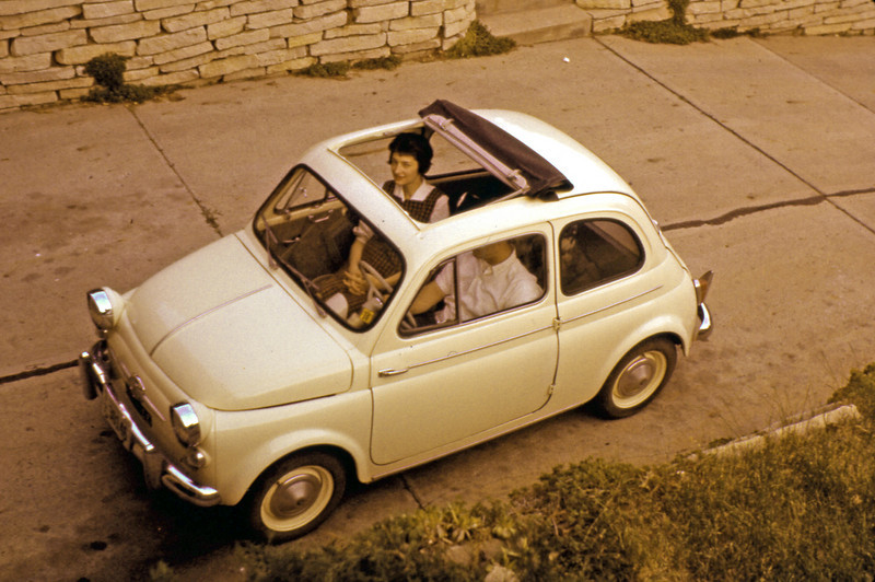 1960, June. Des Moines, Iowa. Looking through the roof of our Fiat 500 Topolino at a pregnant Marian Knox (ninth month).