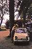 1959, April. Ein Gev, Israel. Marian looks through the sunroof of our Topolino, a Fiat 500 we took delivery of in Paris and brought by Zim Line ship from Marseilles to Haifa.