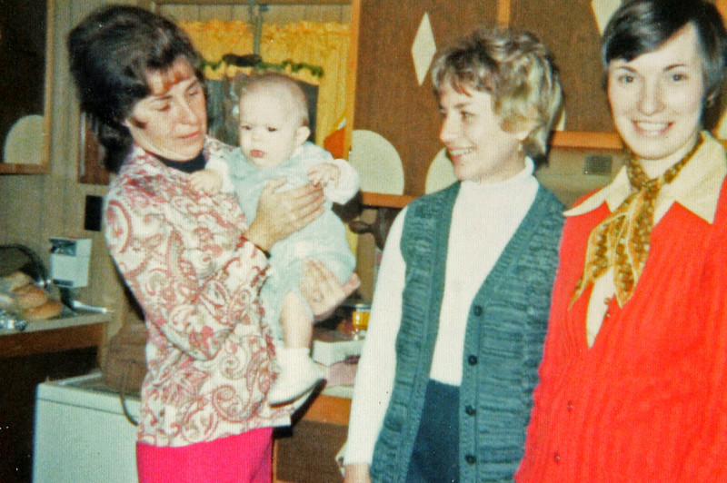 Carol holding Timmy Antanaitis with Evie and Betty standing by, 1970.