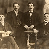 Based on a description in the history compiled by Bernard and Marion Goodkind, these are probably four of the five sons of Isaac and Sophia Goodkind.  The five were Meyer, Moses, Bernard, Henry and Abe, one of whom is missing here.  If Bernard is included in this photo, he is probably third from the left.  Their three sisters were Adeline, Amelia and Hanah.