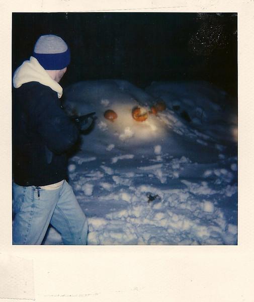 Kevin shooting at pumpkins, fall, 1996.
