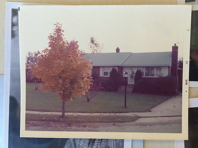 The photo was likely taken in the fall and the film processed the following spring.  The poplar tree is rising over the roofline.