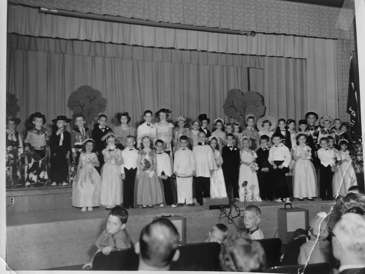 Krebs first grade Moc Wedding show.  Johnny third from left, first row.