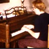 Mom playing her new piano, Fox Spring Road, Augusta GA, circa 1960 or 61.  I still have the same piano!