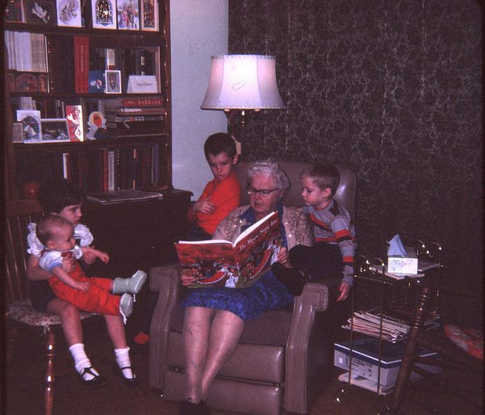 1967 12 2X-FEB68F4_18-Grandma Benoit reads to the kids