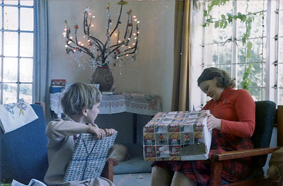Christmas in Lesotho. Mom and James opening presents.