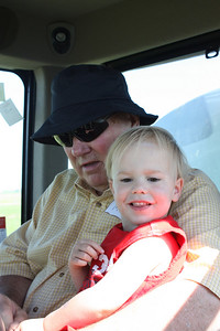 Dad and Archer on the sprayer