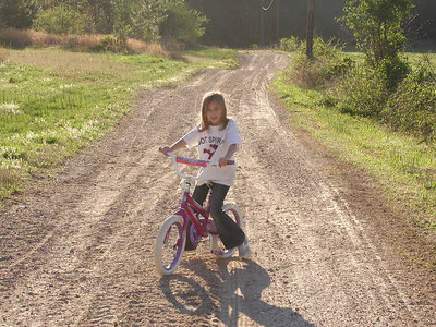 Summer on her bike.