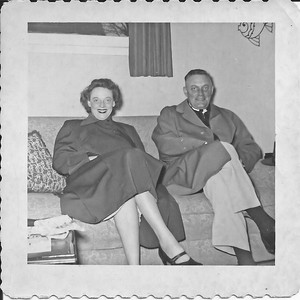 Marion and Pat Henry. Must've been visiting us at the Harrison house apartment. I recognize that ugly fish decoration on the wall, so it's somewhere we were living.