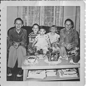 My family, as far as I was concerned. I grew up with them from the age of six months until six years, when we moved back to Minnesota. You know, I have trouble deciding which of the older boys is which, though I think that's Bobbie on the left, with Phil on the right. Tom and Pam behind me.