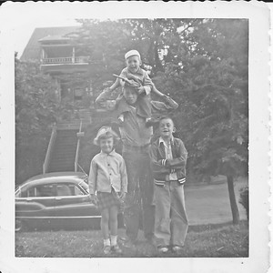 Pam, Tom, me on top, and I think that's Phil lifting me up, though the age doesn't seem quite right.