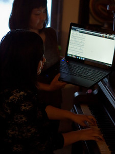 April played piano while checking her email. We are concerned she might have a problem.