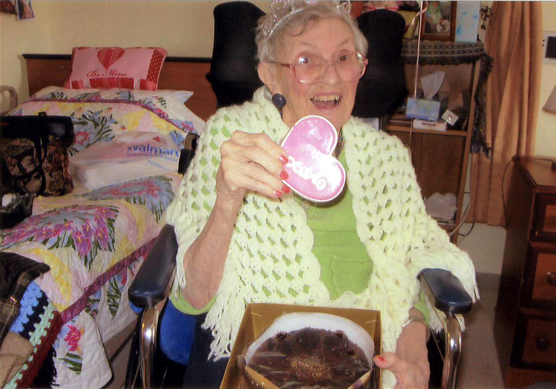 Aunt Jessie's 90th bday, Feb 19, 2010. She looks;FABULOUS! This is a chocolate cake & cookie I sent her from all of us.