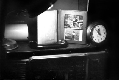 Roy Andersons corner, radio, photo, clock.  What more would you want?