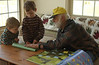 Putting together paper airplane with Grandpa
