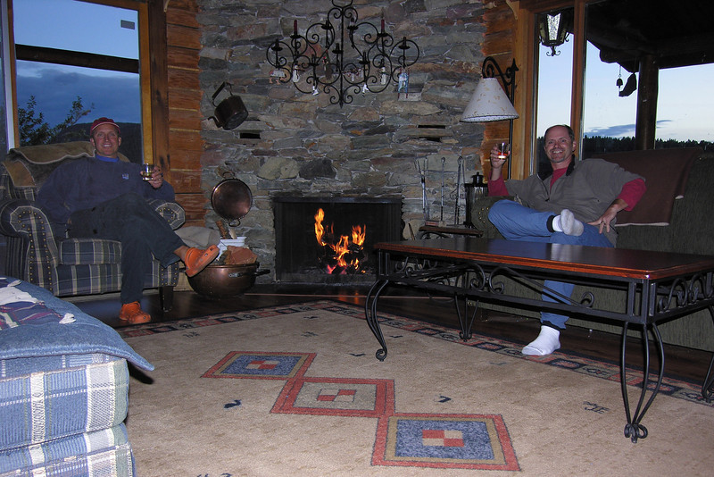 Terry and Tim enjoying a fine scotch next to the fireplace.