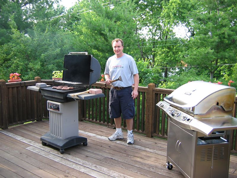 <big>Jay on the deck</big><BR> grilling for the last time on that old grill.<BR> Father's Day 2004