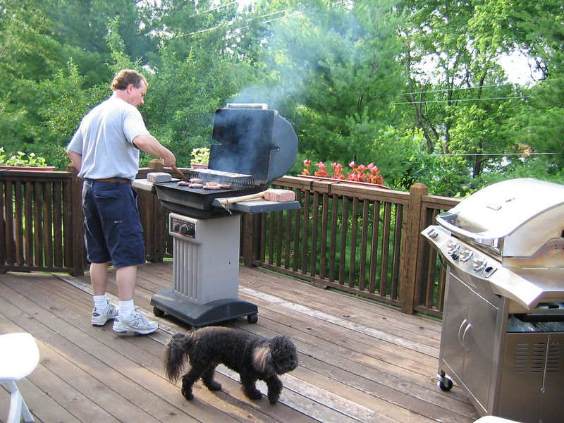 <big>Jay on the deck (with Joey)</big><BR> grilling for the last time on that old grill.<BR> Father's Day 2004