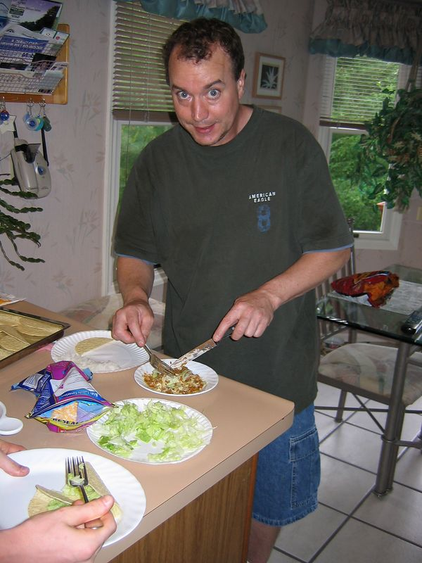 <big>Jay fixing Joey tacos for dinner May 2004