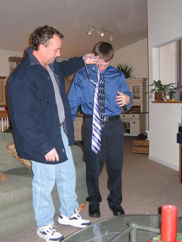 Jay P getting help tying a tie<br /> New Year's Eve 2005
