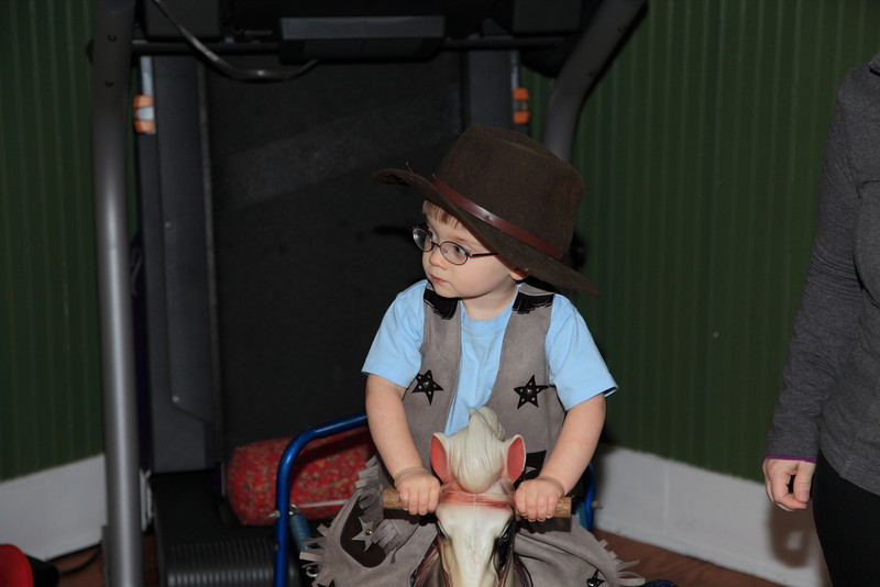 Cowboy Liam has to keep both hands on the horses reins to bring her under control.