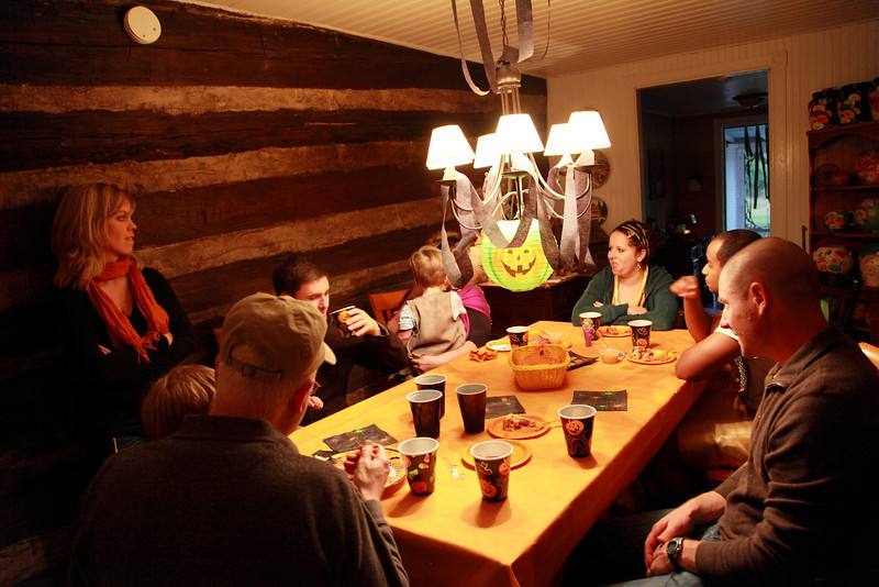 A group gather around our dinning room table. from the top CW,Suzanne, Adize ,Ethan,Uncle Scott ,Liam sitting in Scotts lap,Laurie,Aaron,Sam sitting in Cathy's lap.