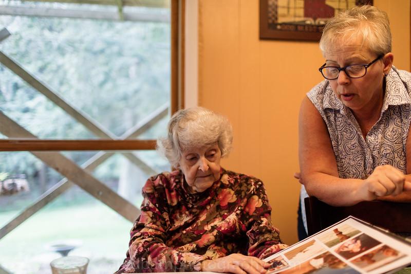 Grandma and Cathy looking at Matthew's Book.