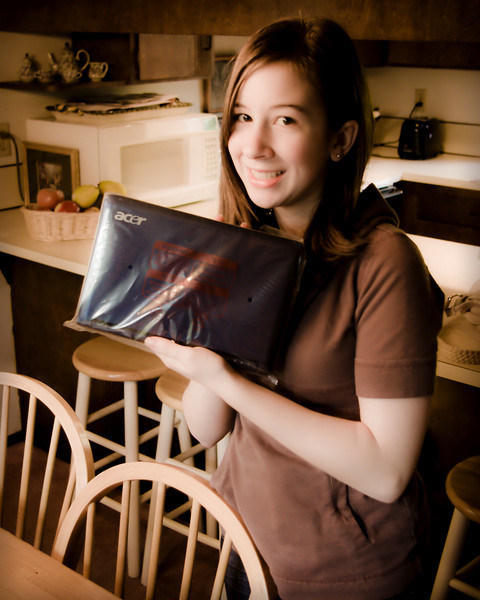 Holding her Acer Aspire One netbook