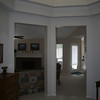 "Entry foyer, called ""the rotunda"" on the plans, looking towards the great room ahead and left"