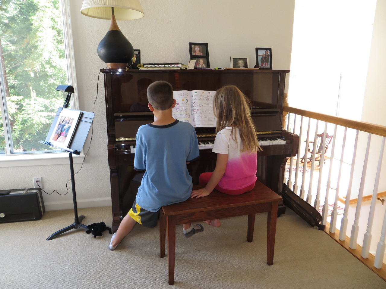Austin and Sofia playing the piano