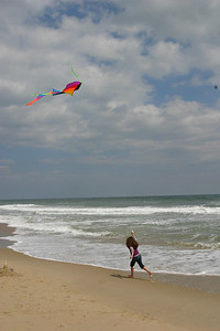Anisa on the beach with a kite.