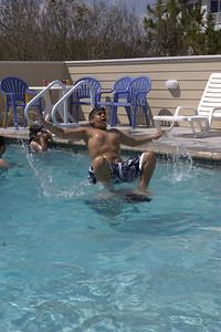 Pool antics.  Zeryab on Ijaz's shoulders.