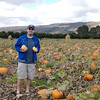 Tom at the pumpkin patch doing the pick your own pumpkin thing.